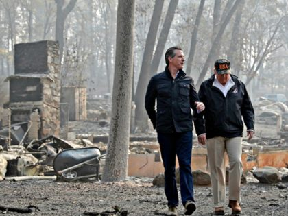 FILE - In this Nov. 17, 2018 file photo, President Donald Trump talks with California Gov.-elect Gavin Newsom, left, as California Gov. Jerry Brown, walks at right during a visit to a neighborhood destroyed by the Camp wildfire in Paradise, Calif. Gov. Gavin Newsom has said he wants to see …