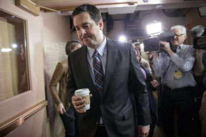 Nunes Walking With Coffee