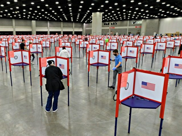 In this June 23, 2020, file photo voting stations are set up in the South Wing of the Kentucky Exposition Center for voters to cast their ballot in the Kentucky primary in Louisville, Ky. Just over four months before Election Day, President Donald Trump is escalating his efforts to delegitimize …
