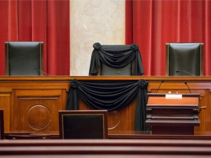 In this Feb. 16, 2016 file photo, Supreme Court Justice Antonin Scalia's courtroom chair is draped in black to mark his death as part of a tradition that dates to the 19th century, at the Supreme Court in Washington. In the year since Scalia's death last February, the court's empty …