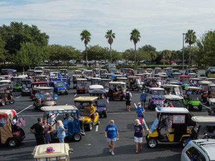 Residents of The Villages, Florida, take part in a golf cart parade on August 21, 2020, to celebrate the nomination of Joe Biden for Democratic presidential candidate and Kamala Harris for vice president. (Photo by CHANDAN KHANNA / AFP) (Photo by CHANDAN KHANNA/AFP via Getty Images)