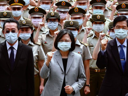 Taiwan President Tsai Ing-wen (C) poses for photographs with Secretary General of National Security Council Wellington Koo (L) and Defense Minister Yen Teh-fa (R) while inspecting the the military police headquarters in Taipei on May 26, 2020. (Photo by Sam Yeh / AFP) (Photo by SAM YEH/AFP via Getty Images)