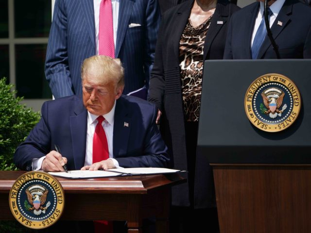 Trump signs PPP (Mandel Gan / Getty)