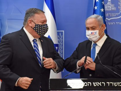 US Secretary of State Mike Pompeo (L) and Israeli Prime Minister Benjamin Netanyahu bump elbows ahead of making a joint statement to the press after meeting in Jerusalem, on August 24, 2020. - Pompeo arrived in Israel kicking off a five-day visit to the Middle East which will take him …