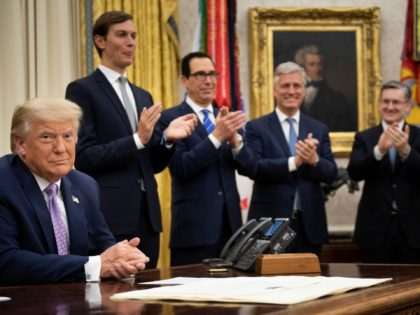 (L-R, rear) Senior Advisor Jared Kushner, US Secretary of the Treasury Steven Mnuchin and National Security Advisor Robert O'Brien clap for US President Donald Trump (L) after he announced an agreement between the United Arab Emirates and Israel to normalize diplomatic ties, the White House August 13, 2020, in Washington, …