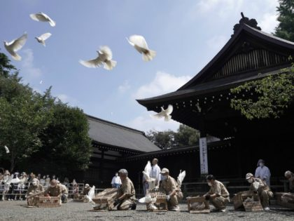 Employees release doves, wishing for the world's peace and paying respects to the war dead at Yasukuni Shrine Saturday, Aug. 15, 2020, in Tokyo. Japan marked the 75th anniversary of the end of World War II. (AP Photo/Eugene Hoshiko)
