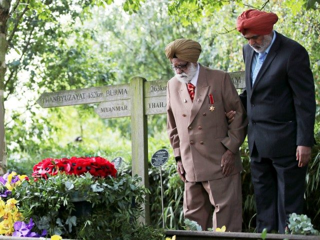 ALREWAS, ENGLAND - AUGUST 15: World War Two veteran Darbara Singh Bhullar, 97, lays a wreath beside Prince Charles, Prince of Wales lays a wreath at the VJ Day National Remembrance event, held at the National Memorial Arboretum in Staffordshire, on August 15, 2020 in Alrewas, England. (Photo by Molly …