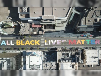 "TOPSHOT - The words ""All Black Lives Matter"" are seen painted on Hollywood Blvd before the start a solidarity march between the LGBTQ+ and Black Lives Matter communities, June 14, 2020 in Hollywood California. - Protests against racism and police brutality continue around the country in the wake of the …"