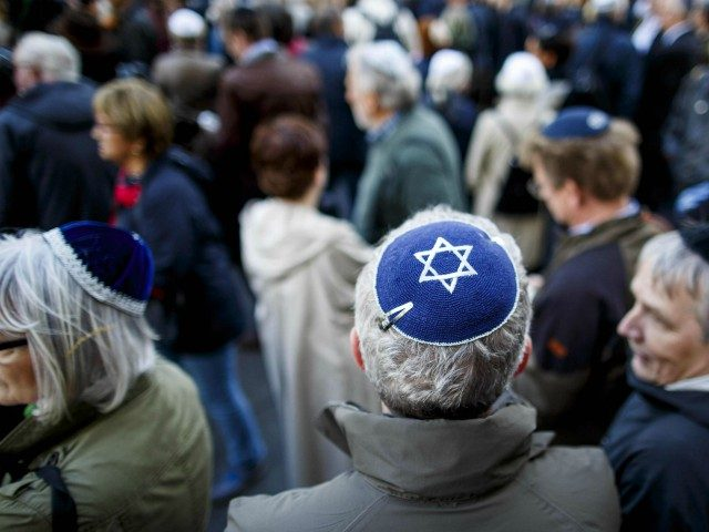 """BERLIN, GERMANY - APRIL 25: Participants wearing a kippah during a """"wear a kippah"""" gathering to protest against anti-Semitism in front of the Jewish Community House on April 25, 2018 in Berlin, Germany. The Jewish community made a public appeal for Jews and non-Jews to attend the event and wear …"""