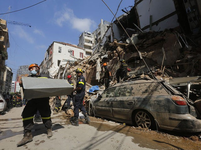 BEIRUT, LEBANON - AUGUST 06: Emergency workers search a collapsed building on August 6, 2020 in Beirut, Lebanon. On Thursday, the official death toll from Tuesday's blast stood at 137, with thousands injured. Public anger swelled over the possibility that government negligence over the storage of tons of ammonium nitrate …