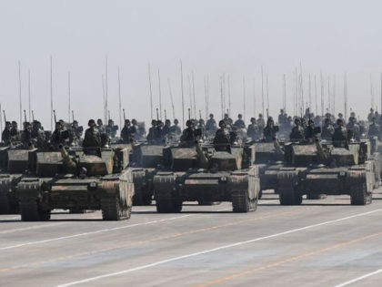Chinese Type 99A tanks take part in a military parade at the Zhurihe training base in China's northern Inner Mongolia region on July 30, 2017. China held a parade of its armed forces on July 30 to mark the 90th anniversary of the People's Liberation Army (PLA) in a display …