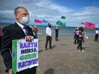 NAIRN, SCOTLAND - JULY 16: Members of Extinction Rebellion groups from Highland and Moray hold a demonstration on Central Beach on July 16, 2020 in Nairn, Scotland. Campaigners held a Heads in the Sand event to draw attention to a G20 meeting later this week. XR members think the G20 …