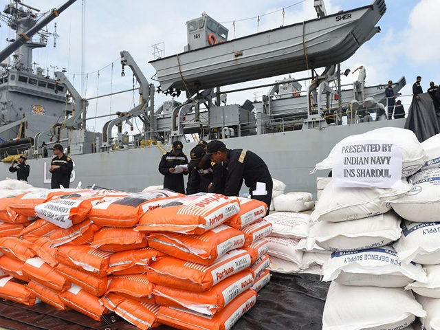 Indian Navy troops offload emergency supplies from the Indian ship Shardul at Colombo harbour in Colombo on May 28, 2017. Emergency teams rushed to distribute aid on May 28 to half a million Sri Lankans displaced after the island's worst flooding in more than a decade claimed 126 lives and …