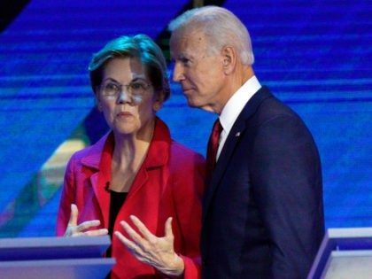 Democratic presidential candidates Sen. Elizabeth Warren, D-Mass., left, and former Vice President Joe Biden talk during a break Thursday, Sept. 12, 2019, in a Democratic presidential primary debate hosted by ABC at Texas Southern University in Houston. (AP Photo/David J. Phillip)