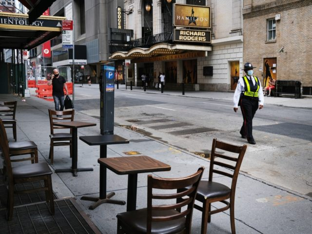 NEW YORK, NEW YORK - JUNE 30: Broadway theaters stand closed along an empty street in the theater district on June 30, 2020 in New York City. The Broadway League, a trade organization representing producers and theater owners, announced on Monday that performances in New York City will be suspended …