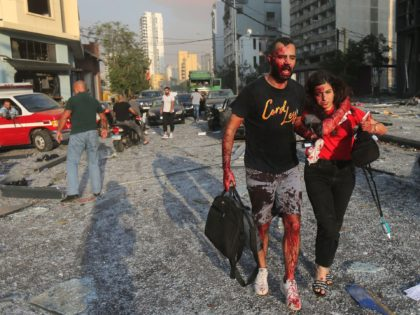 EDITORS NOTE: Graphic content / Wounded people walk near the site of an explosion at the port in the Lebanese capital Beirut on August 4, 2020. - Two huge explosion rocked the Lebanese capital Beirut, wounding dozens of people, shaking buildings and sending huge plumes of smoke billowing into the …