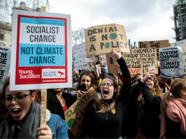 LONDON, ENGLAND - MARCH 15: Schoolchildren take part in a student climate protest on March 15, 2019 in London, England. Thousands of pupils from schools, colleges and universities across the UK will walk out today in the second major strike against climate change this year. Young people nationwide are calling …