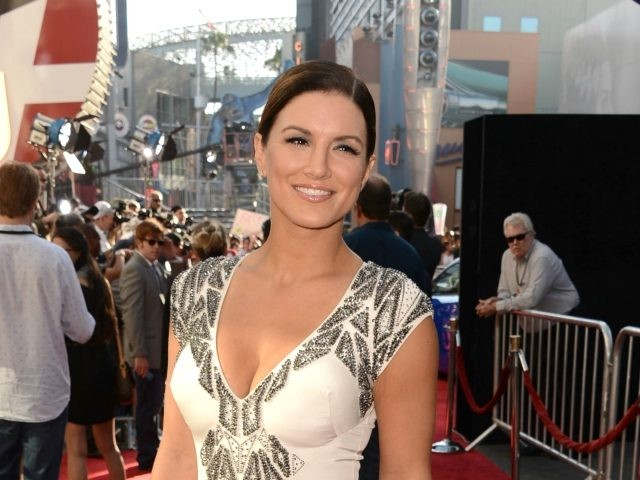 "UNIVERSAL CITY, CA - MAY 21: Actress Gina Carano arrives at the premiere of Universal Pictures' ""Fast & Furious 6"" at Gibson Amphitheatre on May 21, 2013 in Universal City, California. (Photo by Kevin Winter/Getty Images)"