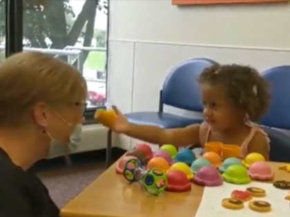 A 2-year-old girl in Kansas is now able to hear her loved ones and the world around her thanks to cochlear implants.