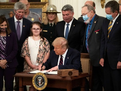WASHINGTON, DC - AUGUST 04: U.S. President Donald Trump signs the Great American Outdoors Act during a singing ceremony in the East Room of the White House on August 4, 2020 in Washington, DC. The new public lands law aims to fix crumbling national park infrastructure and permanently fund The …