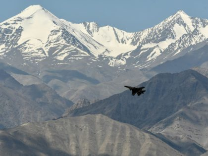 An Indian Air Force aircraft is seen against the backdrop of mountains surrounding Leh, the joint capital of the union territory of Ladakh, on June 27, 2020. - India acknowledged for the first time on June 25 that it has matched China in massing troops at their contested Himalayan border …