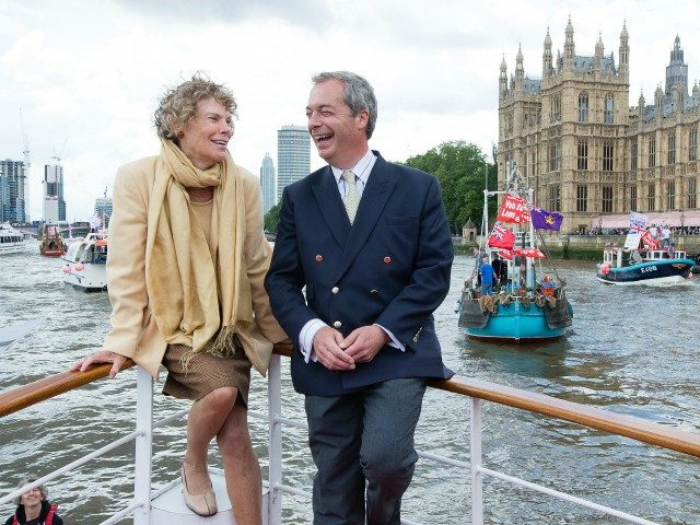 LONDON, ENGLAND - JUNE 15: (L-R) Kate Hoey and Nigel Farage, leader of the UK Independence Party, show their support for the 'Leave' campaign for the upcoming EU Referendum aboard a boat on the River Thames on June 15, 2016 in London, England. Nigel Farage, leader of UKIP, is campaigning …