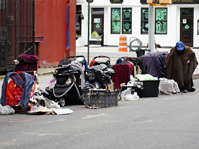 NEW YORK, NEW YORK - MAY 24: A homeless person sits with their belongings on the street during the coronavirus pandemic on May 24, 2020 in New York City. COVID-19 has spread to most countries around the world, claiming over 343,000 lives with over 5.3 million infections reported. (Photo by …