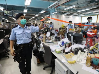 HONG KONG, CHINA - AUGUST 10: A handout photo from Apple Daily showing police officers during a search at the headquarters of Apple Daily after media mogul, Hong Kong business tycoon Jimmy Lai, was arrested at his home on August 10, 2020 in Hong Kong, China. Hong Kong police arrested …