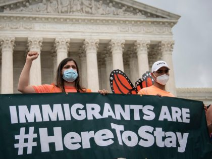 WASHINGTON, DC - JUNE 18: DACA recipients and their supporters rally outside the U.S. Supreme Court on June 18, 2020 in Washington, DC. On Thursday morning, the Supreme Court, in a 5-4 decision, denied the Trump administration's attempt to end DACA, the Deferred Action for Childhood Arrivals program. (Photo by …