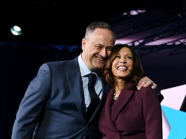 TOPSHOT - Senator from California and Democratic vice presidential nominee Kamala Harris and her husband Douglas Emhoff stand on stage at the end of the third day of the Democratic National Convention, being held virtually amid the novel coronavirus pandemic, at the Chase Center in Wilmington, Delaware on August 19, …