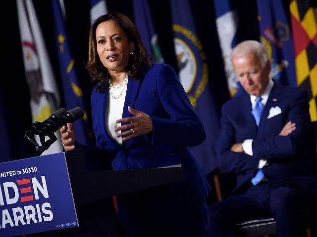 Democratic presidential nominee and former US Vice President Joe Biden listen to his vice presidential running mate, US Senator Kamala Harris, speak during their first press conference together in Wilmington, Delaware, on August 12, 2020. (Photo by Olivier DOULIERY / AFP) (Photo by OLIVIER DOULIERY/AFP via Getty Images)