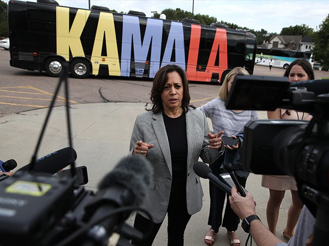 SIOUX CITY, IOWA - AUGUST 08: Democratic presidential candidate, Sen Kamala Harris (D-CA) speaks to reporters after touring Morningside College with Sioux City city councilmember Alex Watters during a campaign stop on August 08, 2019 in Sioux City, Iowa. Kamala Harris kicked off her five day river-to-river bus tour across …