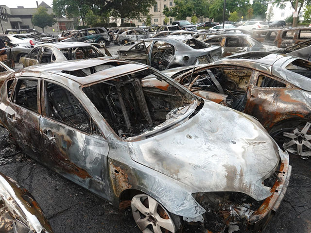 KENOSHA, WISCONSIN - AUGUST 25: Cars sit in a used car lot that was torched the previous evening during another night of unrest on August 25, 2020 in Kenosha, Wisconsin. Rioting as well as clashes between police and protesters began Sunday night after a police officer shot Jacob Blake, an …