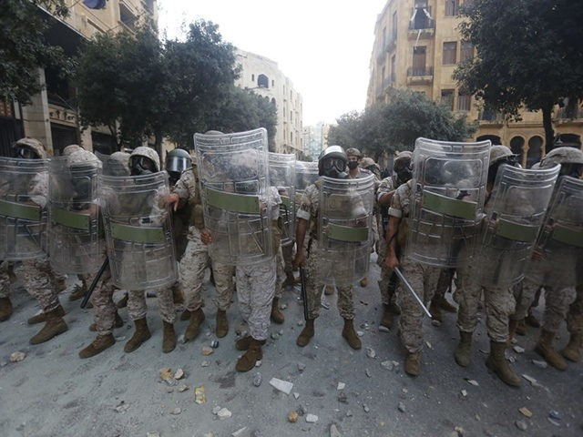 BEIRUT, LEBANON - AUGUST 08: Soldiers stand with shields during anti-government protests on August 8, 2020 in Beirut, Lebanon. The Lebanese capital is reeling from this week's massive explosion that killed at least 150 people, wounded thousands, and destroyed wide swaths of the city. Residents are demanding accountability for the …
