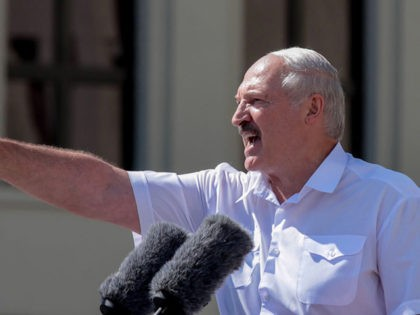 Belarus' President Alexander Lukashenko gestures as he delivers a speech during a rally held to support him in central Minsk, on August 16, 2020. - The Belarusian strongman, who has ruled his ex-Soviet country with an iron grip since 1994, is under increasing pressure from the streets and abroad over …