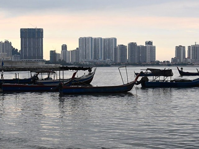 Fishing boats sit idle at the seafront in Penang on May 21, 2020, as Malaysia relaxes its partial lockdown that was set up to contain the spread of the COVID-19 coronavirus. (Photo by GOH CHAI HIN / AFP) (Photo by GOH CHAI HIN/AFP via Getty Images)