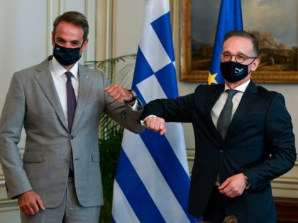 Greek Prime Minister Kyriakos Mitsotakis (L) bumps elbows with Germany's Foreign Minister Heiko Maas (R) before a meeting at Maximos Mansion in Athens, on August 25, 2020. (Photo by STR / Eurokinissi / AFP) (Photo by STR/Eurokinissi/AFP via Getty Images)