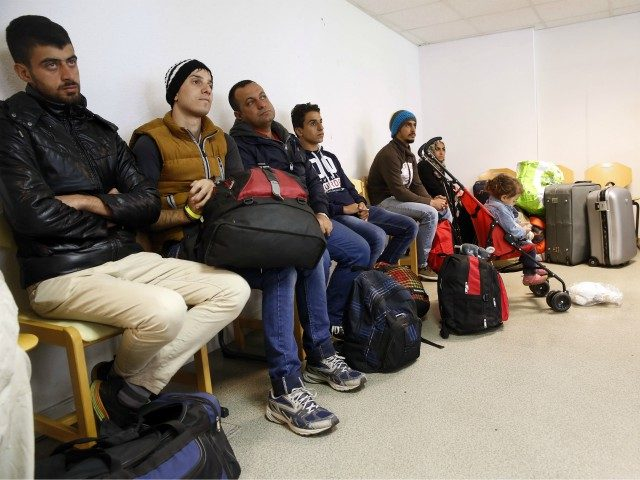 Some of the ninety-three Syrian, Eritrean and Iraqi migrants coming from Germany wait before being directed to their rooms, on September 9, 2015, at the Armade student residence in Champagne-sur-Seine, in a Paris' suburb. Under pressure to respond to Europe's biggest migrant crisis since World War II, French President Francois …
