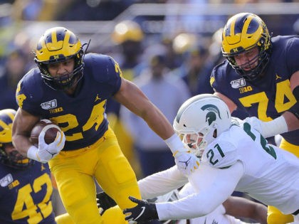 ANN ARBOR, MI - NOVEMBER 16: Zach Charbonnet #24 of the Michigan Wolverines runs for a first down during the third quarter of the game against the Michigan State Spartans at Michigan Stadium on November 16, 2019 in Ann Arbor, Michigan. Michigan defeated Michigan State 44-10. (Photo by Leon Halip/Getty …