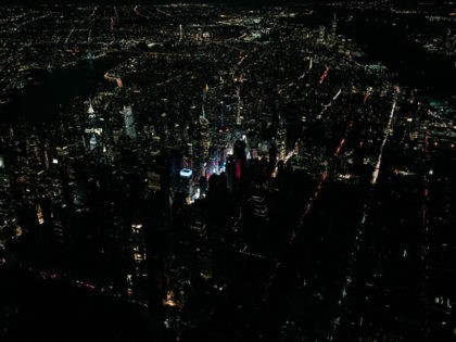 NEW YORK, NY - JULY 13: A large section of Manhattan's Upper West Side and Midtown neighborhoods are seen in darkness from above during a major power outage on July 13, 2019 in New York City. Thousands of New Yorkers are without power as a major outage left portions of …