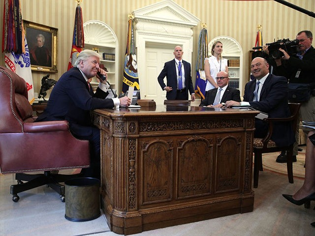 WASHINGTON, DC - JUNE 27: U.S. President Donald Trump (L) speaks on the phone with Irish Prime Minister Leo Varadkar on the phone as National Economic Council Director Gary Cohn (R) and National Security Adviser H. R. McMaster (2nd R) look on in the Oval Office of the White House …