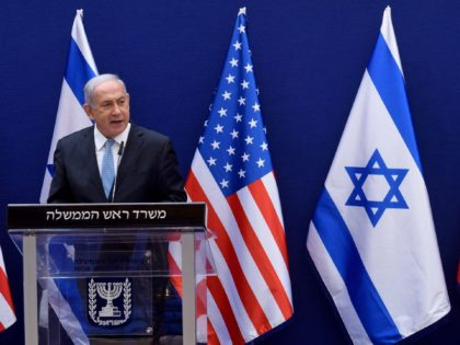 Israeli Prime Minister Benjamin Netanyahu (L) and US Presidential Adviser Jared Kushner make joint statements to the press after their meeting in Jerusalem, on August 30, 2020, about the Israel - United Arab Emirates agreement to normalise relations. (Photo by DEBBIE HILL / POOL / AFP) (Photo by DEBBIE HILL/POOL/AFP …