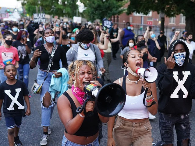 PORTLAND, OR - AUGUST 20: Erandi, center left, and Oria B, center right, two protest organizers who declined to give their last names, lead a peaceful march against racial injustice and police brutality on August 20, 2020 in Portland, Oregon. Rallies and marches with no police interaction often make their …