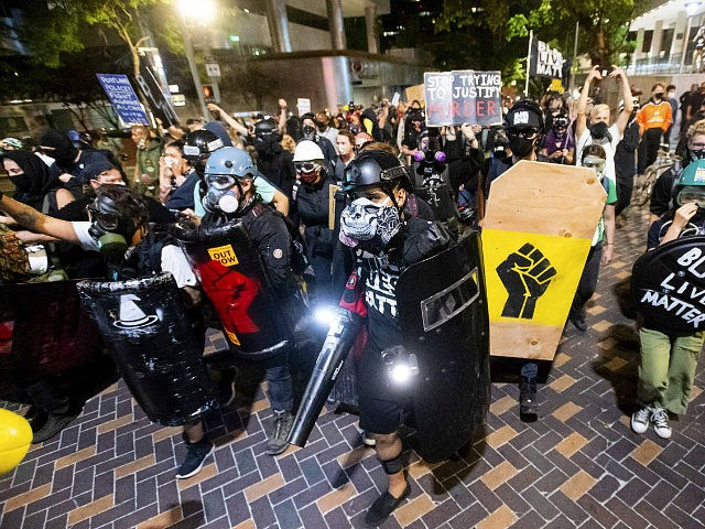 Black Lives Matter protesters march through Portland, Ore. after rallying at the Mark O. Hatfield United States Courthouse on Sunday, Aug. 2, 2020. Following an agreement between Democratic Gov. Kate Brown and the Trump administration to reduce federal officers in the city, nightly protests remained largely peaceful without major confrontations …