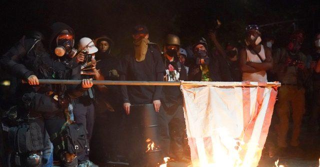 portland rioters burning american flag getty 640x335.'