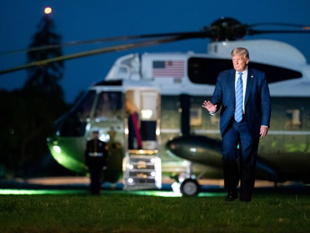 President Donald J. Trump waves after disembarking Marine One on the South Lawn of the White Wednesday, July 29, 2020, following his visit to Texas. (Official White House Photo by Tia Dufour)