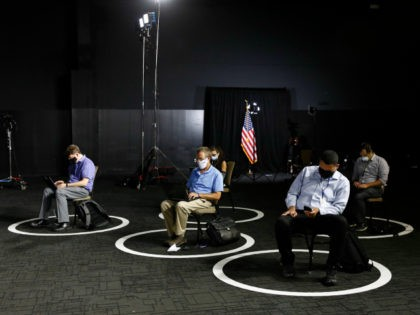 Reporters sit in socially-distant circles before a speech by Democratic presidential candidate, former Vice President Joe Biden, Tuesday, July 14, 2020, in Wilmington, Del. (AP Photo/Patrick Semansky)