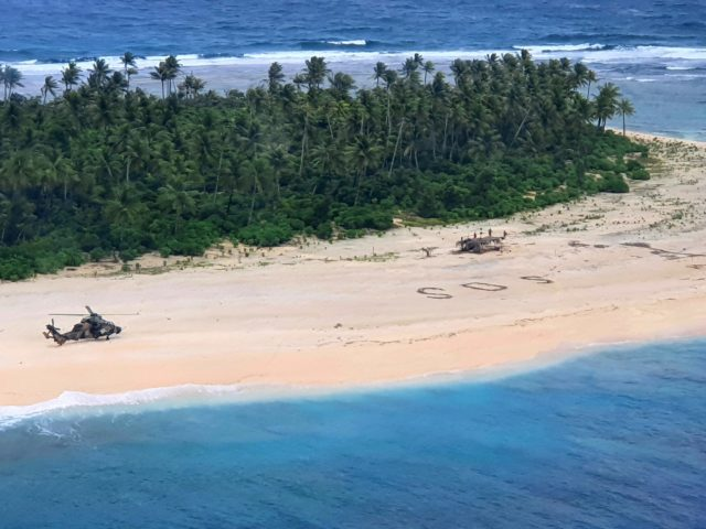 In this photo provided by the Australian Defence Force, an Australian Army helicopter lands on Pikelot Island in the Federated States of Micronesia, where three men were found, Sunday, Aug. 2, 2020, safe and healthy after missing for three days. The men were missing in the Micronesia archipelago east of …