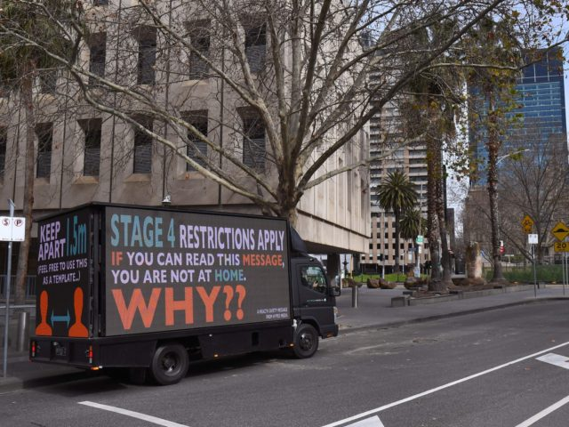 A sign on a truck warns people to stay home in Melbourne on August 5, 2020, as the city enforces strict lockdown restrictions after a fresh outbreak of the COVID-19 coronavirus. - Australia's worst-hit state of Victoria reported 725 new cases and 15 coronavirus deaths on August 5, including a …