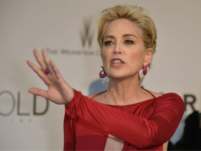 US actress Sharon Stone poses as she arrives for the amfAR 21st Annual Cinema Against AIDS on the sidelines of the 67th Cannes Film Festival at Hotel du Cap-Eden-Roc in Cap d'Antibes, southern France, on May 22, 2014. AFP PHOTO / ALBERTO PIZZOLI (Photo credit should read ALBERTO PIZZOLI/AFP via …